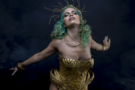 Priestess Latin woman with green hair and gold costume with handmade flourishes, fantasy image and tale Imagens