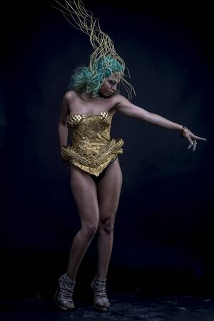 sexy latina: Power, Latin woman with green hair and gold costume with handmade flourishes, fantasy image and tale