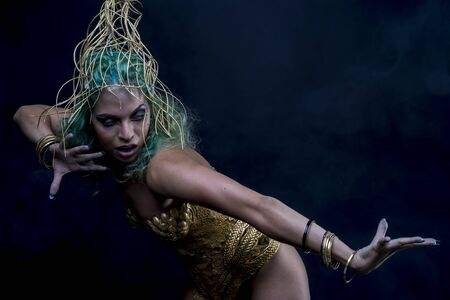 sexy latina: Golden Latin woman with green hair and gold costume with handmade flourishes, fantasy image and tale