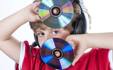 presence: Blonde boy with music helmet on his head and musical records or cds in his hands