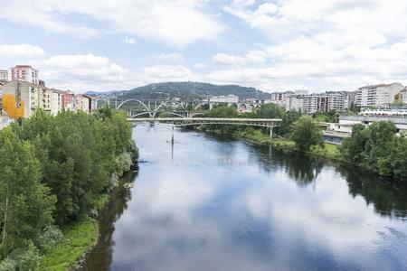 Miño river passing through Orense Roman city located in Galicia. Spain