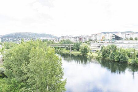 sil: Miño river passing through Orense Roman city located in Galicia. Spain