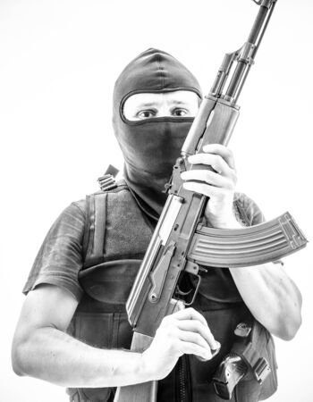 Terrorism, man armed with balaclava and bulletproof vest, gun and shotgun