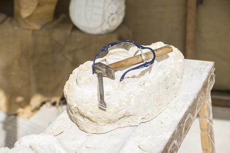 Carver, Traditional medieval sculpture tools in an old market in the fiestas of Alcalá de Henares, Madrid Spain