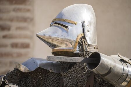 medieval iron armor with helmet and chain mail Stock Photo