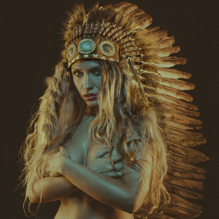 tribal, beautiful girl with plume of american indian feathers