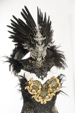 dark gothic dress formed by a silver metal tiara and a golden corset, handmade costume Stock Photo
