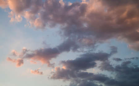 Cloudscape, Sky with clouds and sunlight at sunset. colorful and cheerful, wallpaper or texture
