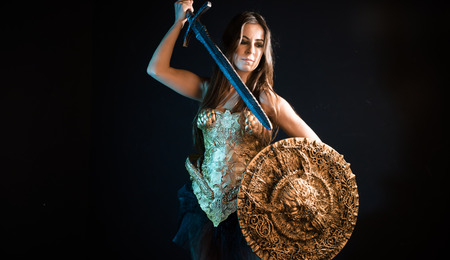 Woman warrior with golden armor iron coat and big warrior sword