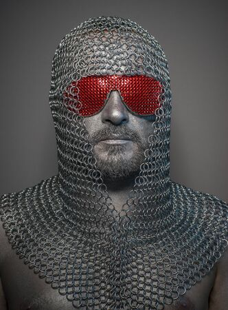 Network firewall, man with iron armor and red glasses, concept of protection and computer security Stock Photo