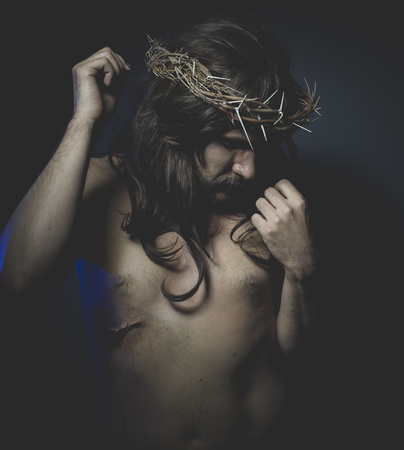 Christianity Jesus of Nazareth, representation of the Calvary of Jesus, son of God. He has the wound on his side and the crown of thorns Stock Photo