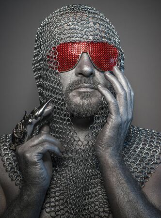 information firewall, man with iron armor and red glasses, concept of protection and computer security