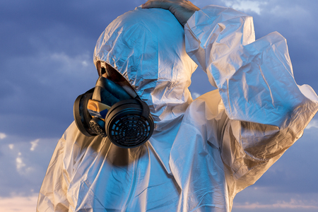 air contaminated by pollution, man with mask and protective suit, concept of biological diseases and environmental problems