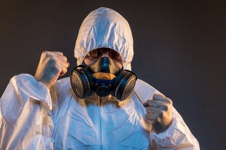 Safety virus infection concept. Man in protective suit and antigas mask with glasses. Ebola, toxic gases, biological warfare, infections and diseases Stock Photo