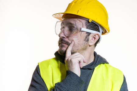 Do it yourself, man dressed in yellow builder helmet with protective glasses ready to start the construction work Banque d'images - 97991897