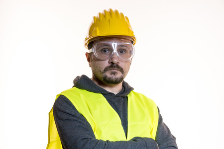 Job, Do it yourself, man dressed in yellow builder helmet with protective glasses ready to start the construction work