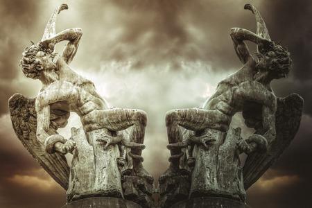 concept of fallen angel, demons and punishment of God. Devil sculpture in madrid, spain Imagens
