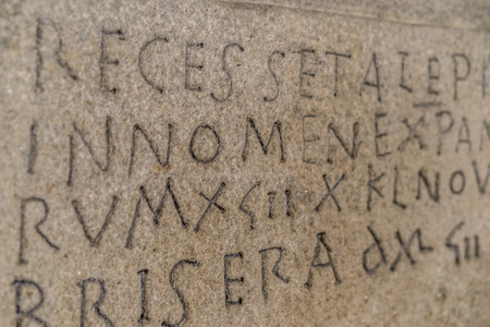 Script, ancient writing in latin and ancient spanish carved on the stone inside a gothic cathedral in spain Stock Photo