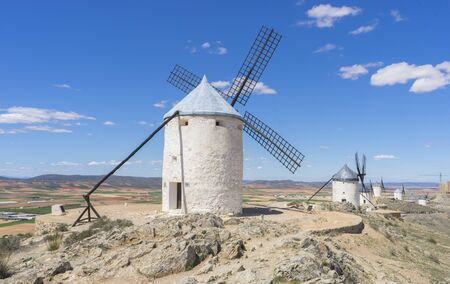 Beautiful summer above the windmills on the field in Spain Stock Photo