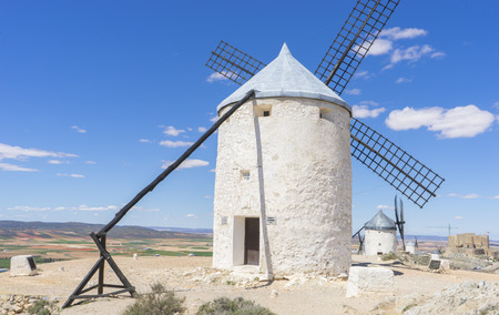 Travel, Beautiful summer above the windmills on the field in Spain