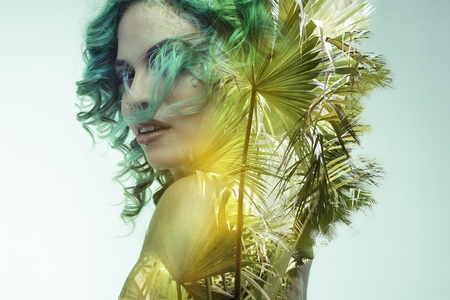 double exposure, beautiful woman with green hair fused with wild and tropical jungle