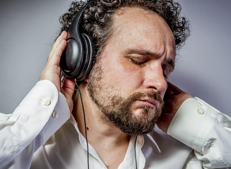 enjoy the music, man with intense expression, white shirt Stock Photo