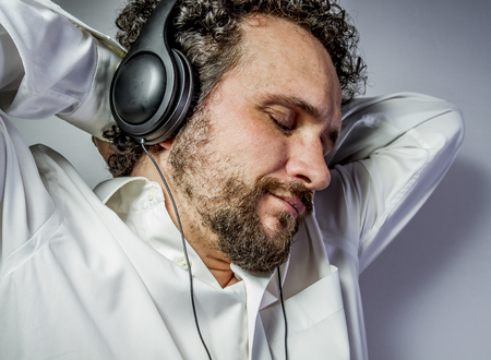classical music, man with intense expression, white shirt Stock Photo