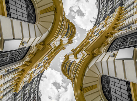 Abstract architecture, neoclassical building with great curves over cloudy sky. change of perspective and point of view that generates a new and surprising effect