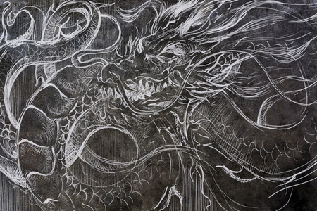 Dragon, Tattoo drawing on concrete wall with colorful chalk effect. textured background and color with handmade drawing.