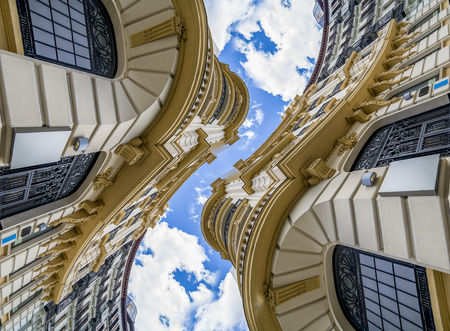Futuristic, Abstract architecture, neoclassical building with great curves over cloudy sky. change of perspective and point of view that generates a new and surprising effect Banco de Imagens