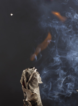 Burning cigarette with smoke on black background Stock Photo - 105510066