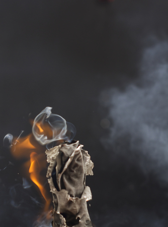 Burning cigarette with smoke on black background Stock Photo