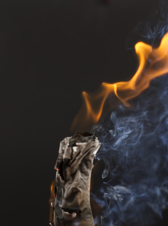 Burning cigarette with smoke on black background Stock Photo - 105520662
