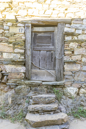 Old door, wood and stone houses in the province of Zamora in Spain