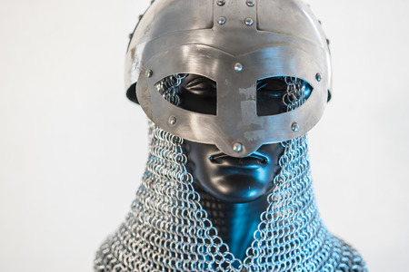 Viking helmet with chain mail in a black mannequin on white background. clothes for the viking war Stockfoto