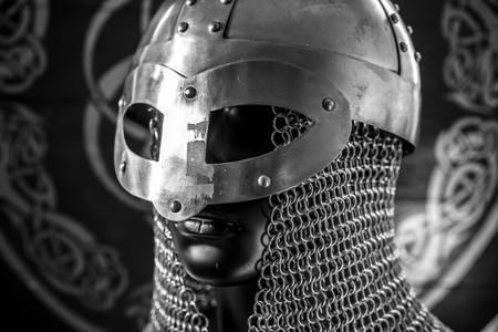 antivirus or firewall concept, Viking warrior helmet with chainmail over silver shield Stock Photo