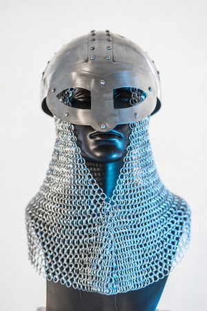 Viking helmet with chain mail in a black mannequin on white background. clothes for the viking war Stock Photo