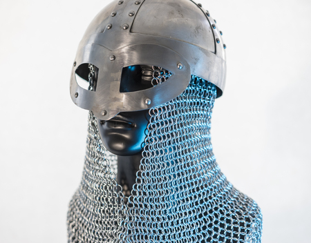 Viking helmet with chain mail in a black mannequin on white background. clothes for the viking war Stock Photo - 106037303