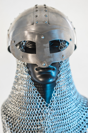 Viking helmet with chain mail in a black mannequin on white background. clothes for the viking war Stock Photo - 106037379