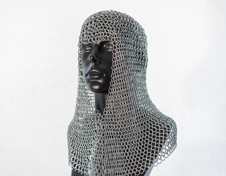 Metal, Viking helmet with chain mail in a black mannequin on white background. clothes for the viking war Stock Photo - 106037382