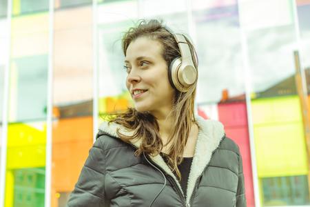 Smiling beautiful woman using technology