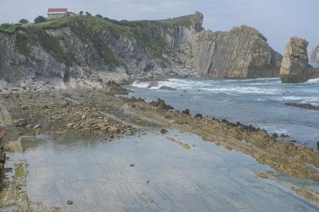Scenic, Rocks on the beach. Dramatic view of Playa de la Arnia, rocky coastline in Santander ,Cantabria, Spain.