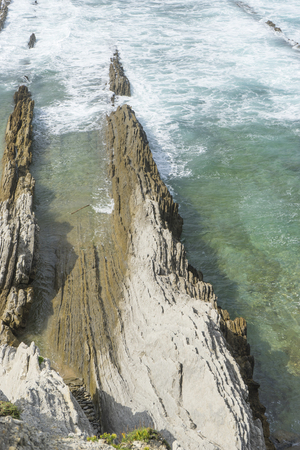 Rocks on the beach. Dramatic view of Playa de la Arnia, rocky coastline in Santander ,Cantabria, Spain. Stock Photo