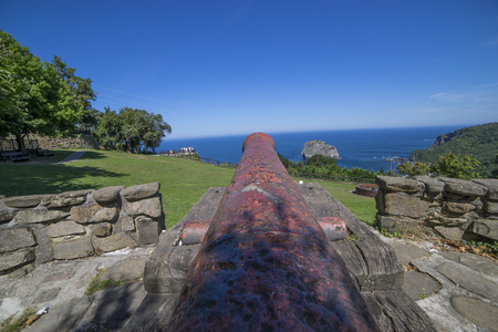 Defense, Iron Canon at Coast of the Basque Country in north of Spain Stock Photo