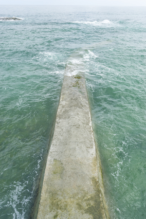 detail of artificial breakwater made of concrete in the Cantabrian Sea, Spain Stock Photo