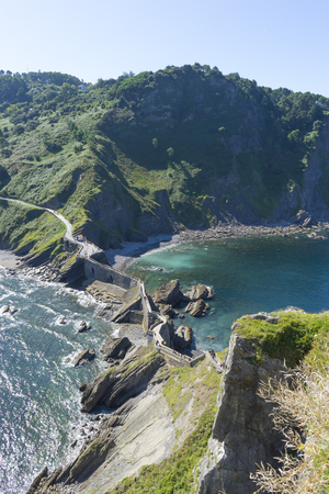 path with stairs, San Juan Gaztelugatxe island view, basque country, historical island with chapel in Northern Spain Stock Photo