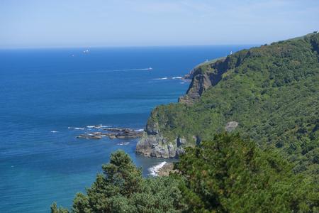 Summer sea, San Juan Gaztelugatxe island view, basque country, historical island with chapel in Northern Spain