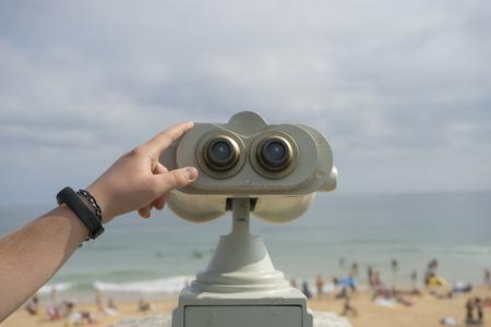 Coin operated binocular on the summer beach, tourist scene in Spain Stock Photo