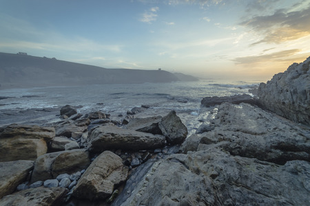 Environment, Sunset in Tagle beach. panoramic view of nice colorful huge cliff and sea on the back. Cantabria. Spain. Stock Photo