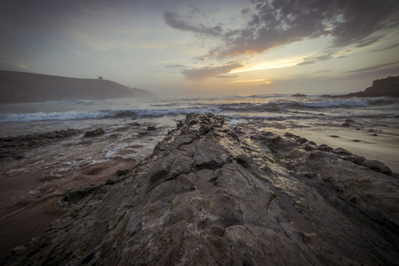 Santander, Sunset in Tagle beach. panoramic view of nice colorful huge cliff and sea on the back. Cantabria. Spain. Stock Photo